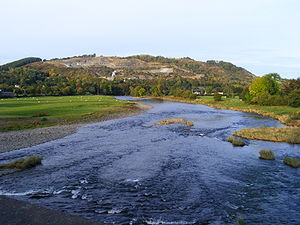 Llanelwedd quarries from the River Wye near Bu...